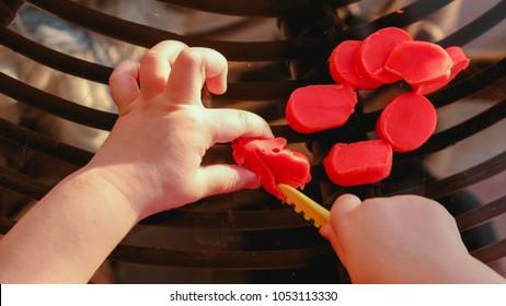 baby hands cutting plasticine - fine motor skill develop dexterity