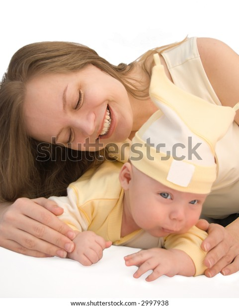 a baby is in the hands of a young mother