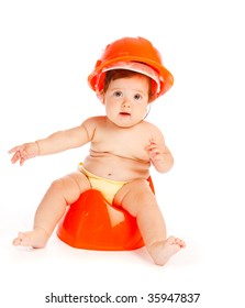 Baby in hardhat sitting on the potty