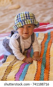 Baby in hat on vacation