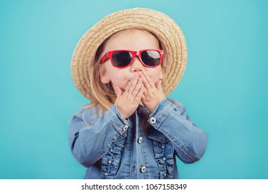 baby with hat and sunglasses