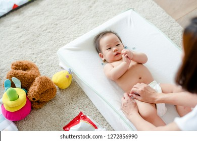Baby having a change of diaper