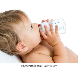 baby holding bottle and drinking milk ot water