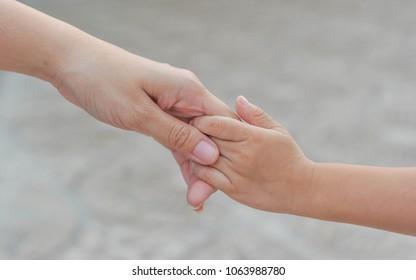 baby holding hand