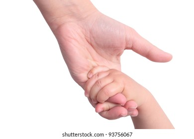 Baby holding mother's hand on white