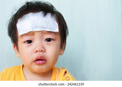 Baby illness medicine flu fever and cooling forehead.