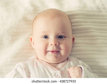 Baby infant home portrait on bad cute happy smile