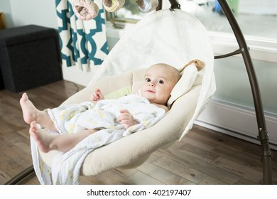 A baby inside the house having good time