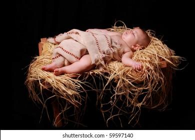 Baby Jesus asleep in the manger