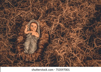 Baby Jesus laying in a manger Christmas background
