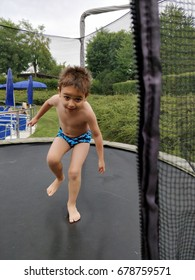 baby jumping on trampoline