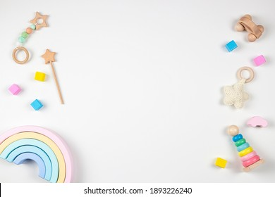Baby kids toys frame on white background. Top view. Flat lay. Copy space for text