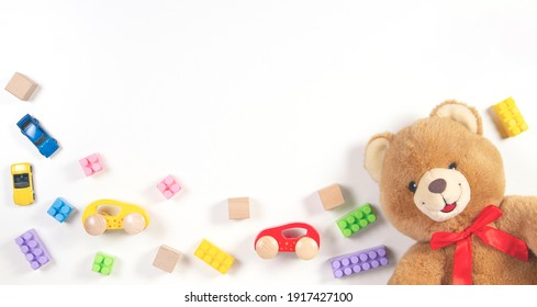 Baby kids toys frame on white background. Top view. Flat lay.