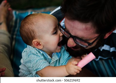 Baby kisses to daddy