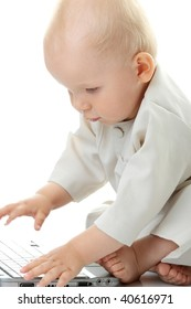 Baby with laptop on the white background