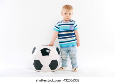 baby with a large ball on a white background
