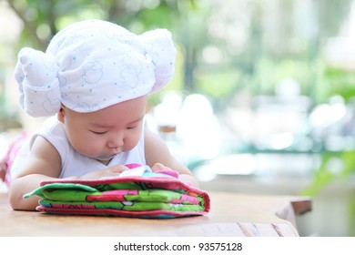 Baby laying in the garden see the baby book