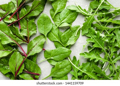 Baby leaves of vegetables. Farm fresh green salad leafs. Beet, arugula, and baby spinach. Vegetarian diet. Healthy nutrition concept.
