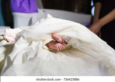 baby legs at christening