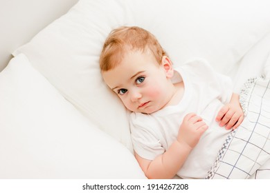 baby lie on pillow and look up