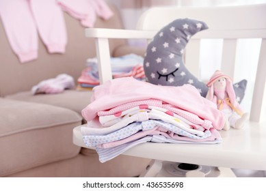 Baby linen on chair indoors
