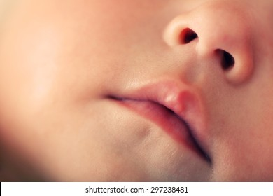 Baby lips and nose, closeup