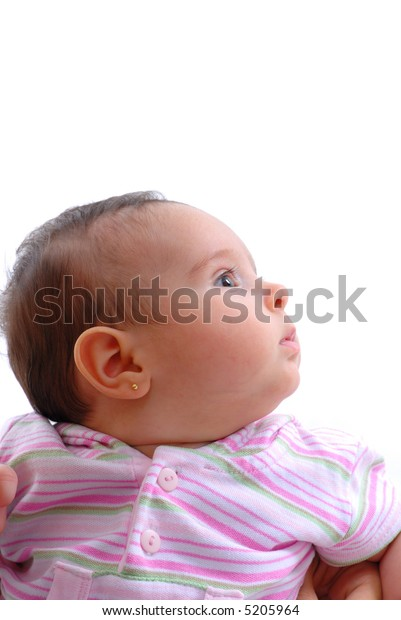 Baby looking at... on white background.