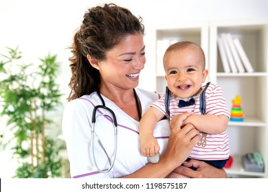 Baby looking with curiosity as doctor looks back with approval in her eyes