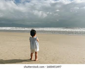 Baby looking sea at beach