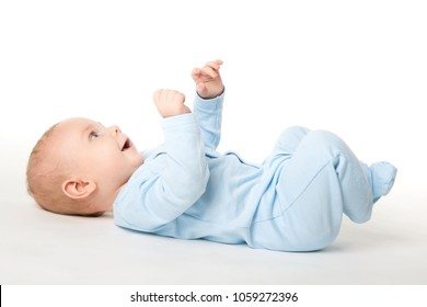 Baby Lying on Back, Happy Infant Kid Dressed in Blue Bodysuit, Beautiful Child Lie on White background looking up