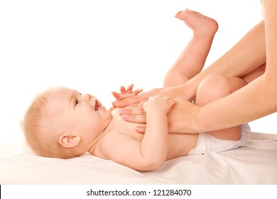 Baby massage. Mother massaging kid belly, baby laughing. Treatment of colic. Isolated on white background