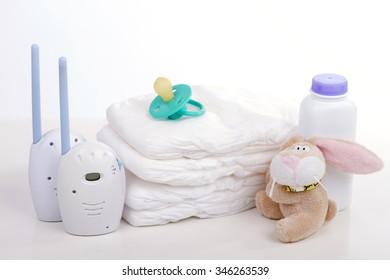 baby monitor, diapers. pacifier nipple. Toy hare - safety and care of the baby