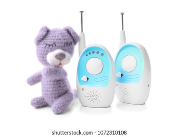 Baby monitor units and toy on white background. Radio nanny