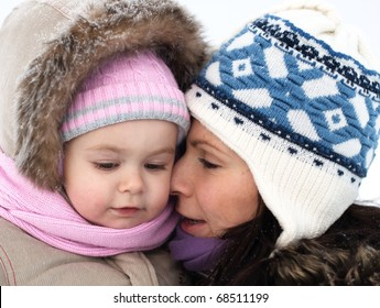 Baby and mother in cold winter day