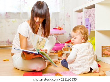 Baby and mother with picture book