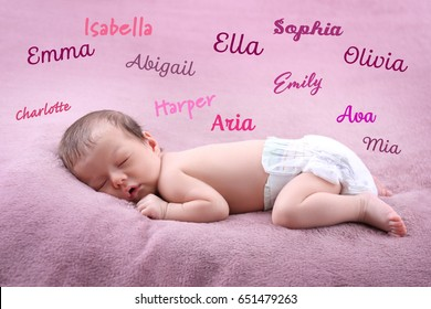 Baby names concept. Cute little girl sleeping on plaid
