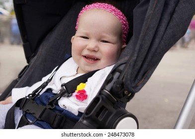 Baby with new teeth in stroller