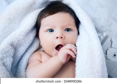 baby, newborn baby cute blue-eyed, dark hair, baby 2 months without clothes, close-up portrait