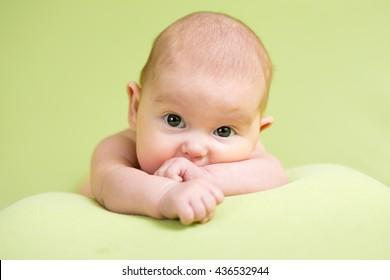 Baby newborn infant kid lying on belly