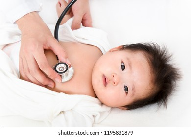 Baby of a newborn baby undergoing a doctor's examination with a stethoscope. Health, illness, medical examination, treatment, image