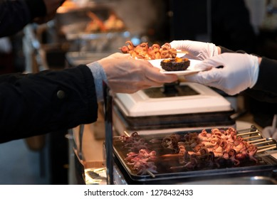 Baby octopus and uni (sea urchin) grilled and sold at Tsukiji Fish Market in Tokyo, Japan