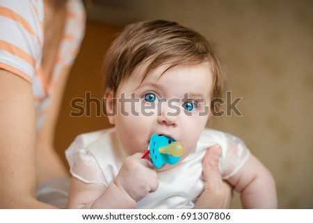 baby on bed little girl pacifier stock photo edit now 691307806