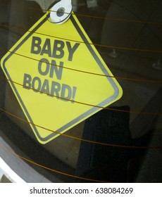 baby on board on the car glass