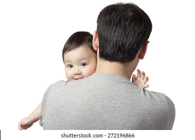 baby on father's shoulders. child in the arms of his father
