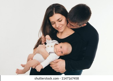 baby on the hands of parents on a white background.