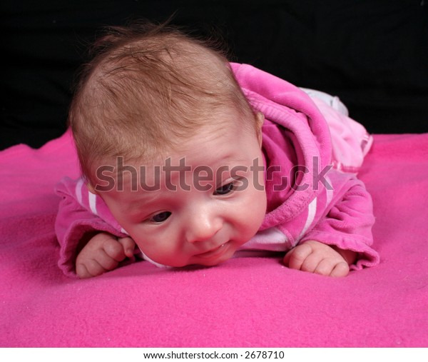 Baby on pink