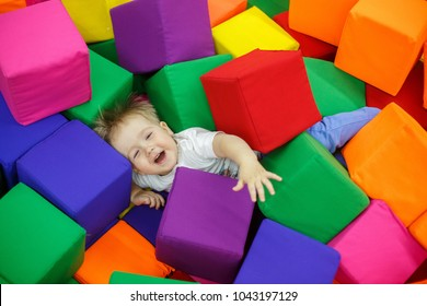 baby on trampoline. child in the playroom. boy in a pool with balls rest in the children's center. child in the entertainment center The boy plays in the playing room happy childhood