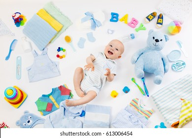 Baby on white background with clothing, toiletries, toys and health care accessories. Wish list or shopping overview for pregnancy and baby shower. View from above. Child feeding, changing and bathing