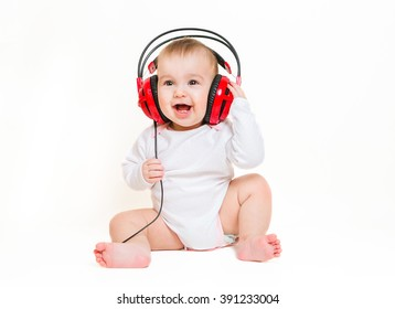 Baby on a white background with headphones listening to music