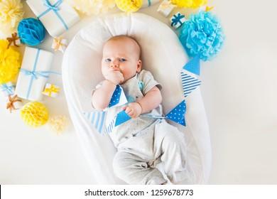 Baby On Yellow White Clothing Toiletries Stock Photo Edit Now